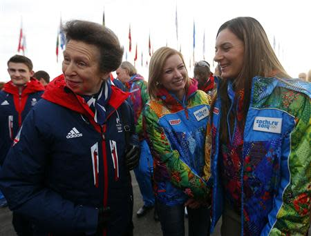 Britan's Princess Anne talks with Russian pole vaulter and Mayor of the Coastal Cluster Olympic Village Yelena Isinbayeva (R), during the welcoming ceremony for the British Olympic team in the Athletes Village at the Olympic Park ahead of the 2014 Winter Olympic Games in Sochi February 6, 2014. REUTERS/Laszlo Balogh