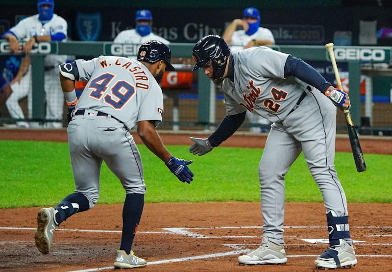 Detroit Tigers shortstop Willi Castro (49) celebrates with designated hitter Miguel Cabrera (24) after hitting a home run against the Kansas City Royals during the third inning Sept. 24, 2020, at Kauffman Stadium.