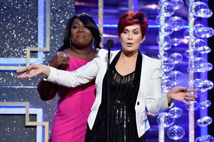 TV personality Sheryl Underwood watches and listens as Sharon Osbourne lets a few f-bombs fly.