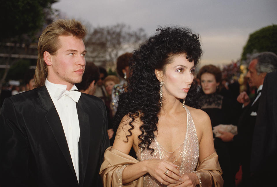 American actors Cher and Val Kilmer arrive at the 56th Academy Awards, where Cher is nominated for Best Supporting Actress in Silkwood. (Photo by Bill Nation/Sygma via Getty Images)