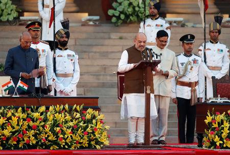 India's President Ram Nath Kovind administers Amit Shah's oath of office during a swearing-in ceremony at the presidential palace in New Delhi, India May 30, 2019. REUTERS/Adnan Abidi
