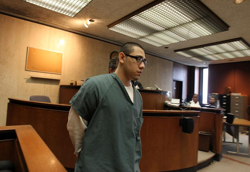 Alexander Alfaro enters the courtroom before his sentencing at the Essex County Courthouse in Newark, N.J., Thursday, May, 19, 2011. Alfaro, the third of six defendants in a schoolyard triple murder, was sentenced to more than 200 years in prison by a judge who cast aside his argument that he was coerced into the attack by an older half-brother who was the head of a violent street gang. (AP Photo/John O'Boyle, Pool)