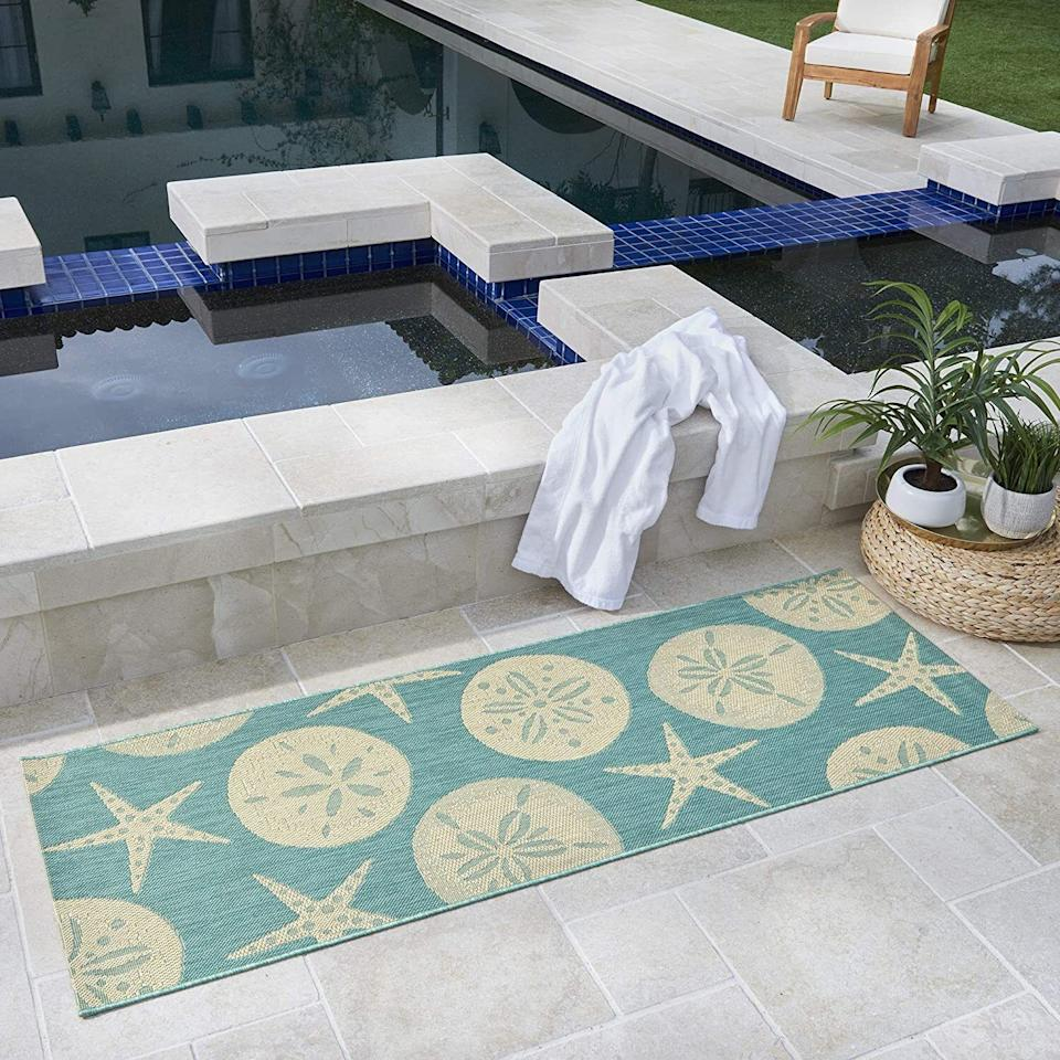 """Add a touch of the sea to your outdoor furniture setup. The rug's material also feels nice on your feet and is really easy to clean. (Spills and messes, be gone!)<br /><br /><strong>Promising review:</strong>""""The colors are what was pictured (often times hard to tell online). It is more textured and detailed than I thought from seeing it online.<strong>Also, it washes well. The first day I put it out, my child dropped some chocolate ice cream on it, and I was able to wash it off immediately with just water from a watering can!</strong>"""" —<a href=""""https://amzn.to/3vgjPpE"""" target=""""_blank"""" rel=""""nofollow noopener noreferrer"""" data-skimlinks-tracking=""""5580838"""" data-vars-affiliate=""""Amazon"""" data-vars-href=""""https://www.amazon.com/gp/customer-reviews/R5O91NYWW5EEJ?tag=bfgenevieve-20&ascsubtag=5580838%2C26%2C33%2Cmobile_web%2C0%2C0%2C1159948"""" data-vars-keywords=""""cleaning"""" data-vars-link-id=""""1159948"""" data-vars-price="""""""" data-vars-product-id=""""16176939"""" data-vars-retailers=""""Amazon"""">Amazon Customer</a><br /><br /><strong>Get it from Amazon for<a href=""""https://amzn.to/3ncGTTC"""" target=""""_blank"""" rel=""""nofollow noopener noreferrer"""" data-skimlinks-tracking=""""5580838"""" data-vars-affiliate=""""Amazon"""" data-vars-asin=""""B084HQK9BR"""" data-vars-href=""""https://www.amazon.com/dp/B084HQK9BR?tag=bfgenevieve-20&ascsubtag=5580838%2C26%2C33%2Cmobile_web%2C0%2C0%2C1159926"""" data-vars-keywords=""""cleaning"""" data-vars-link-id=""""1159926"""" data-vars-price="""""""" data-vars-product-id=""""16176938"""" data-vars-product-img=""""https://m.media-amazon.com/images/I/41R6fYGOVFL.jpg"""" data-vars-product-title=""""Gertmenian Tropical Modern Outdoor Rug Simple Patio Carpet Sand Dollar Starfish Oasis Green 2x6 Runner"""" data-vars-retailers=""""Amazon"""">$40.50+</a>(available in five sizes).</strong>"""