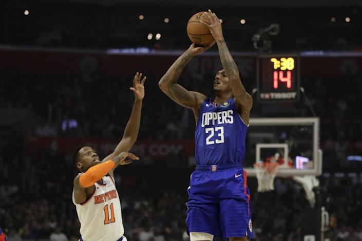 "Clippers guard Lou Williams shoots over the New York Knicks' Frank Ntilikina during the first half on Jan. 5 at Staples Center. <span class=""copyright"">(Marcio Jose Sanchez / Associated Press)</span>"