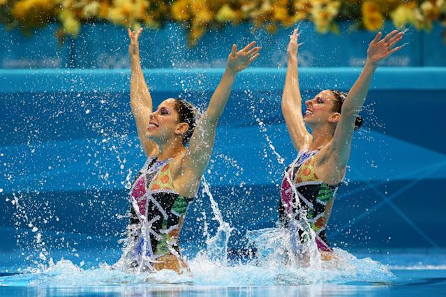Nayara Figueira and Lara Teixeira of Brazil compete in the Women's Duets Synchronised Swimming Technical Routine on Day 9 of the London 2012 Olympic Games at the Aquatics Centre on August 5, 2012 in London, England. (Photo by Al Bello/Getty Images)