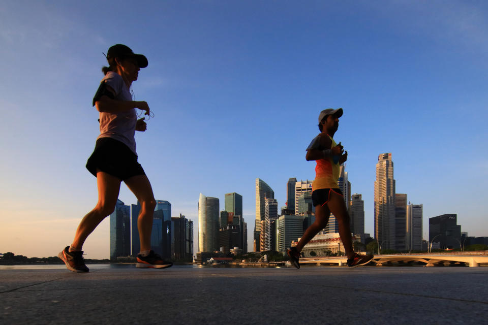 People jogging around the Marina Bay area on 15 February. (PHOTO: Getty Images)