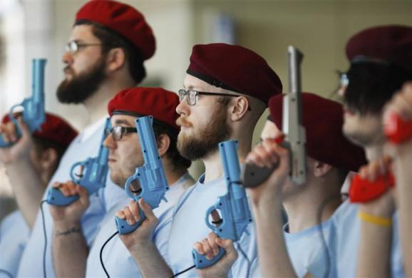 "Members of retro gamer Keith Apicary's ""security force"" stand in formation with video game guns at the PAX East gaming conference in Boston, Massachusetts, April 7, 2012."