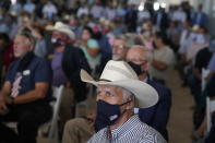 People listen as President Donald Trump delivers remarks about American energy production during a visit to the Double Eagle Energy Oil Rig, Wednesday, July 29, 2020, in Midland, Texas. (AP Photo/Evan Vucci)