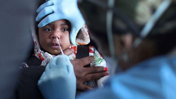 PHOTO: A child is tested for the COVID-19 virus at Roseland Community Hospital, Dec. 14, 2020, in Chicago, Illinois. (Scott Olson/Getty Images, FILE)