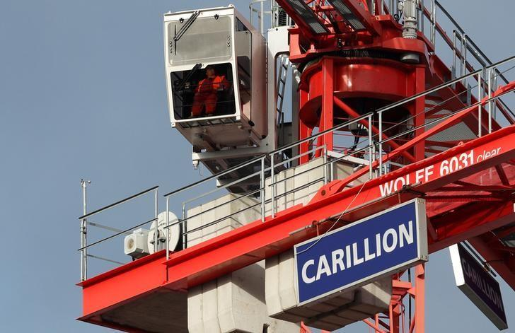 A worker operates a crane on Carillion's Midland Metropolitan Hospital construction site in Smethwick