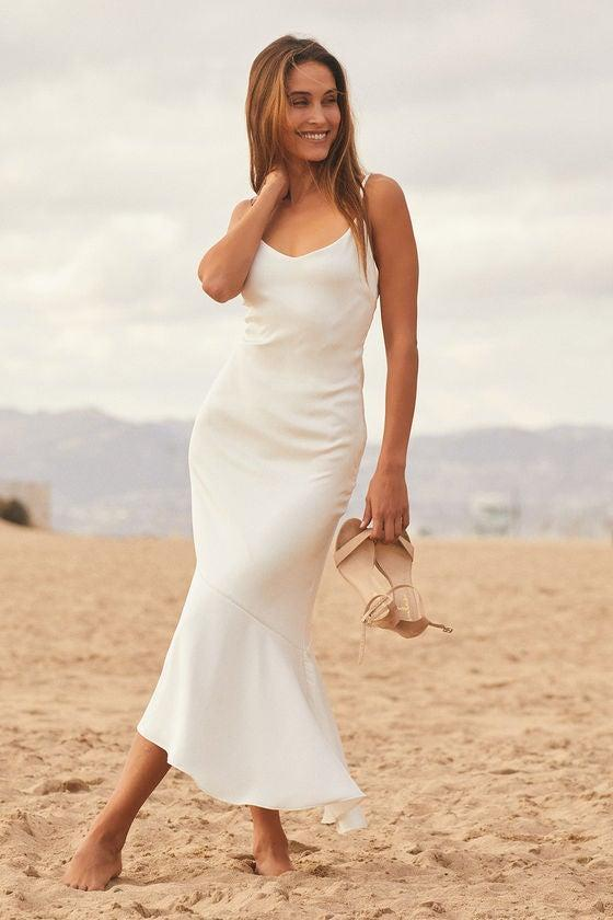 """<h2>Strictly Romance White Satin Asymmetrical Tiered Midi Dress</h2><br>Six customers gave this svelte slip dress a four out of five-star rating for its sleek fit. Customer Maria called it """"figure-hugging and beautiful."""" At 155 lbs. with a 29"""" waist, the bride-to-be was """"expecting [the dress] to be baggy and boxy in the waist, but [was] pleasantly surprised that it fits like a glove! The fabric feels like it's good quality,"""" she continued, """"and I love how feminine it is.""""<br><br><strong>Lulus</strong> Strictly Romance White Satin Asymmetrical Tiered Midi Dress, $, available at <a href=""""https://go.skimresources.com/?id=30283X879131&url=https%3A%2F%2Fwww.lulus.com%2Fproducts%2Fstrictly-romance-white-satin-asymmetrical-tiered-midi-dress%2F1376376.html"""" rel=""""nofollow noopener"""" target=""""_blank"""" data-ylk=""""slk:Lulus"""" class=""""link rapid-noclick-resp"""">Lulus</a>"""