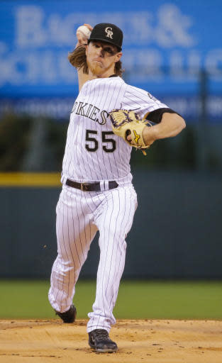 Colorado Rockies starting pitcher Jon Gray throws against the Philadelphia Phillies during the first inning of a baseball game on Monday, Sept. 24, 2018, in Denver. (AP Photo/Jack Dempsey)