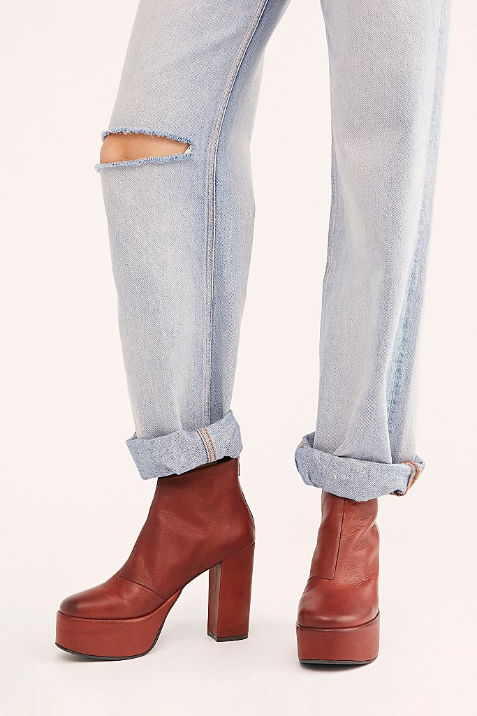 """<h3>Red</h3><br>You need this surprisingly go-with-everything color in your boot rotation to combat black-and-brown fatigue.<br><br><strong>FP Collection</strong> Lucy Platform Boots, $, available at <a href=""""https://go.skimresources.com/?id=30283X879131&url=https%3A%2F%2Fwww.freepeople.com%2Fshop%2Flucy-platform-boots%2F"""" rel=""""nofollow noopener"""" target=""""_blank"""" data-ylk=""""slk:Free People"""" class=""""link rapid-noclick-resp"""">Free People</a>"""