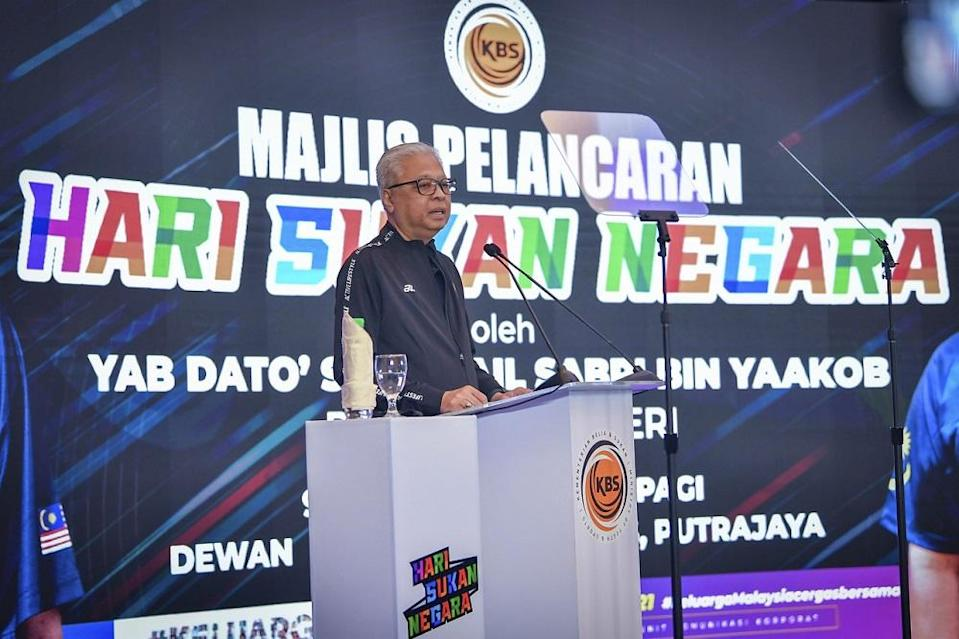 Prime Minister Datuk Seri Ismail Sabri Yaakob speaks during the opening ceremony of National Sports Day 2021 (HSN2021) at the Ministry of Youth and Sports (KBS) in Putrajaya, October 9, 2021. — Bernama pic