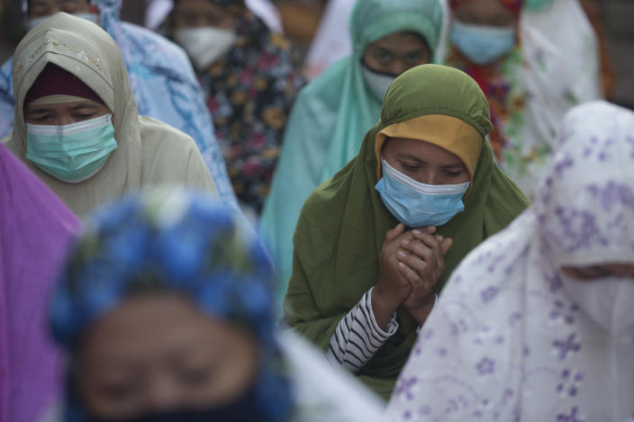 Muslim women pray during the Eid al-Fitr celebration in Bali, Indonesia on Thursday, May 13, 2021. Indonesian Muslims perform Eid al-Fitr prayer that marks the end of the holy fasting month of Ramadan. (AP Photo/Firdia Lisnawati)