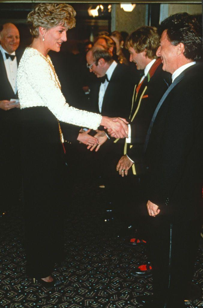 <p>At the premiere of <em>Hook </em>in 1992, the actor wore a standard tuxedo. Princess Diana marked the occasion with a white beaded and black velvet gown by Catherine Walker. </p>