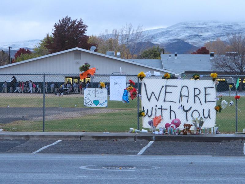 Students return to Sparks Middle School on Monday morning, Oct. 28, 2013, for the first time since Oct. 21, when a 12-year-old student gunned down a teacher and wounded two classmates before killing himself. Police don't know why seventh grader Jose Reyes killed 45-year-old Michael Landsberry and shot two 12-year-old boys before turning the handgun on himself. AP Photo/Scott Sonner)