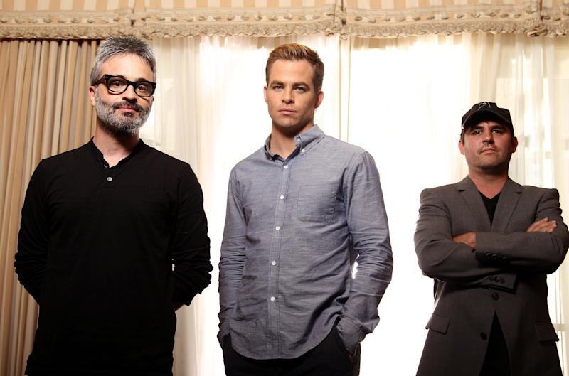 "This June 15, 2012 photo shows writer-director Alex Kurtzman, left, actor Chris Pine, center, and writer-producer Roberto Orci from the film ""People Like Us"", posing for a portrait in Beverly Hills, Calif. The earthbound sibling drama ""People Like Us,"" is light-years from Pine's role as forceful ladies man Kirk in ""Star Trek. And it's a departure for director Kurtzman and producer Orci, who moonlighted on the intimate screenplay for nearly eight years as they co-wrote such action epics as ""Star Trek"" the first two ""Transformers"" flicks, ""Mission: Impossible III"" and ""Cowboys & Aliens."" (Photo by Matt Sayles/Invision/AP)"