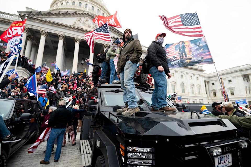 Trump supporters stand on U.S. Capitol Police armored vehicles as others take over the steps of the Capitol on Jan. 6, 2021. (Photo: Bill Clark/CQ-Roll Call, Inc via Getty Images)
