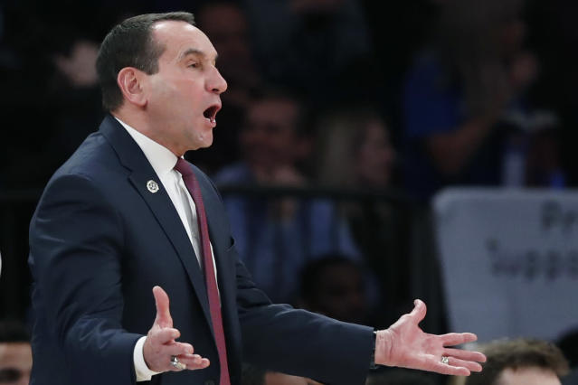 Duke coach Mike Krzyzewski gestures during the first half of the team's NCAA college basketball game against Georgetown in the 2K Empire Classic, Friday, Nov. 22, 2019 in New York. (AP Photo/Kathy Willens)