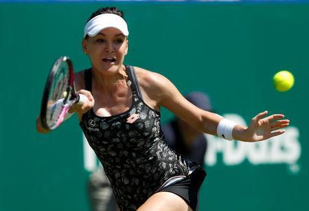 FILE PHOTO: Tennis - WTA Premier & ATP 250 - Nature Valley International - Devonshire Park, Eastbourne, Britain - June 28, 2018 Poland's Agnieszka Radwanska in action during her quarter final match against Latvia's Jelena Ostapenko Action Images via Reuters/Paul Childs/File Photo