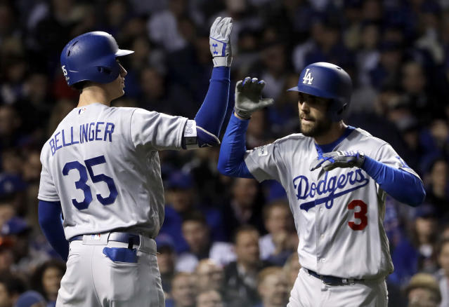 Los Angeles Dodgers' Chris Taylor (3) celebrates his home run with Cody Bellinger (35) during the third inning of Game 3 of baseball's National League Championship Series against the Chicago Cubs, Tuesday, Oct. 17, 2017, in Chicago. (AP)