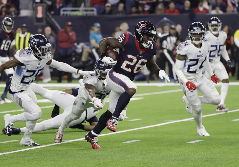 Lamar Miller made some history with his 97-yard touchdown run against the Titans. (AP)