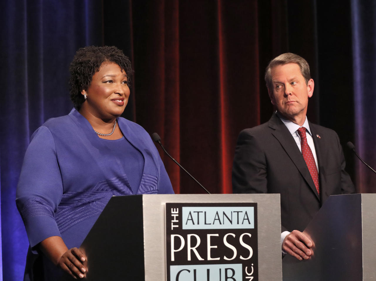 Democratic gubernatorial candidate for Georgia Stacey Abrams, left, speaks as her Republican opponent Secretary of State Brian Kemp looks on during a debate Tuesday, Oct. 23, 2018, in Atlanta. (AP Photo/John Bazemore)