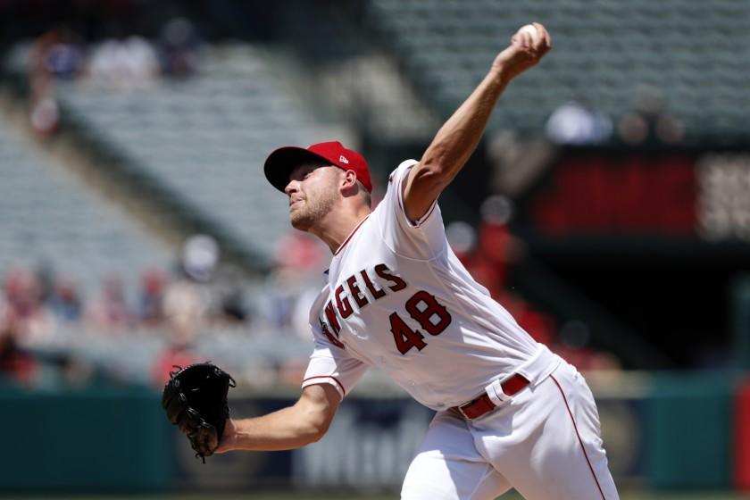 Los Angeles Angels starting pitcher Reid Detmers throws to a Houston Astros batter during the second inning of a baseball game in Anaheim, Calif., Sunday, Aug. 15, 2021. (AP Photo/Alex Gallardo)