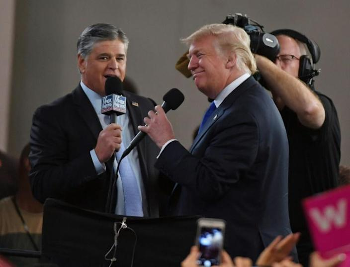 Fox News talk show host Sean Hannity (L) has been strongly supportive of Donald Trump, though the US president has grown skeptical of some others at Fox; the two men are seen here at a September 20, 2018 rally in Las Vegas, Nevada (AFP Photo/Ethan Miller)