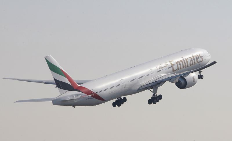 An Emirates Airlines Boeing 777-300 aircraft takes off during the second day of the Dubai Airshow