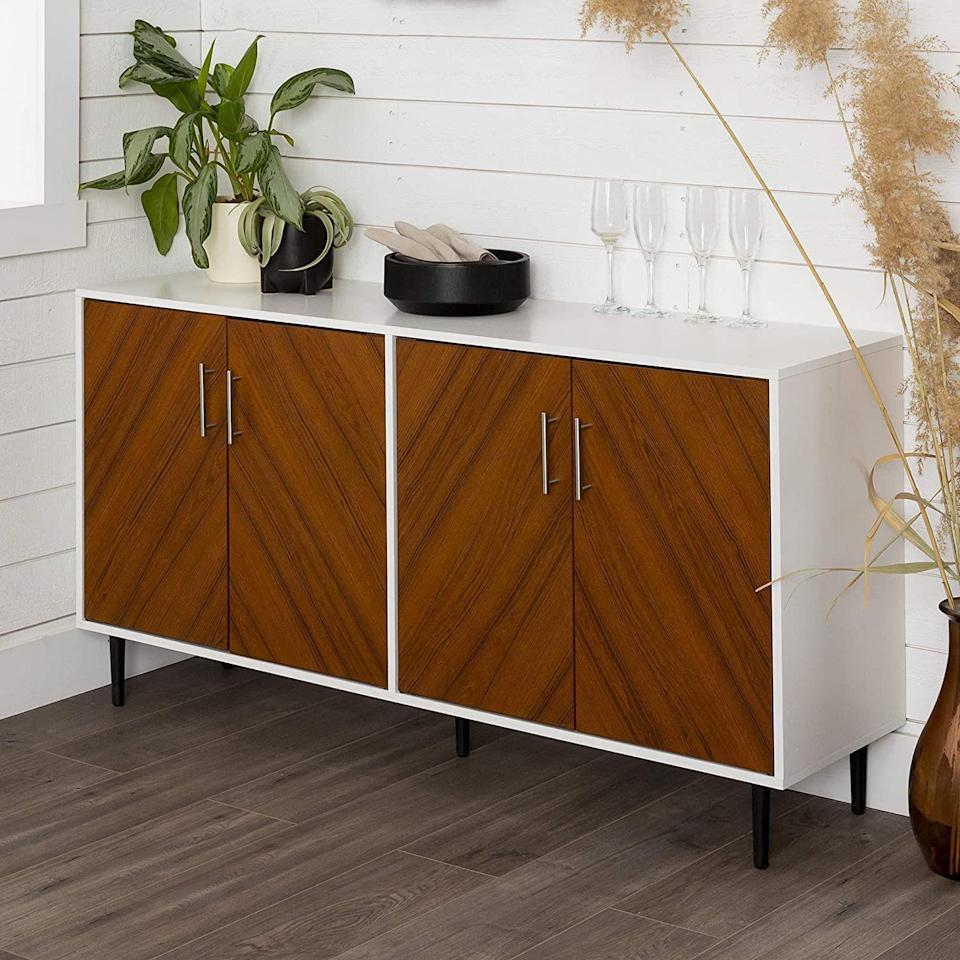"""<p><strong>Walker Edison Furniture Company</strong></p><p>amazon.com</p><p><strong>$360.42</strong></p><p><a href=""""https://www.amazon.com/dp/B07BS6YVC2?tag=syn-yahoo-20&ascsubtag=%5Bartid%7C10057.g.34196286%5Bsrc%7Cyahoo-us"""" rel=""""nofollow noopener"""" target=""""_blank"""" data-ylk=""""slk:BUY NOW"""" class=""""link rapid-noclick-resp"""">BUY NOW</a></p><p>This mid-century inspired pick makes a sleek statement whether you use it as a media console in the living room <em>or </em>a buffet in the dining room.</p>"""