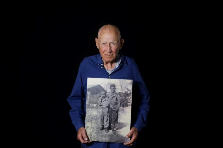 Danny Chanoch is still affected by having seen survivors eating the bodies of prisoners killed by the Nazis (AFP Photo/MENAHEM KAHANA)