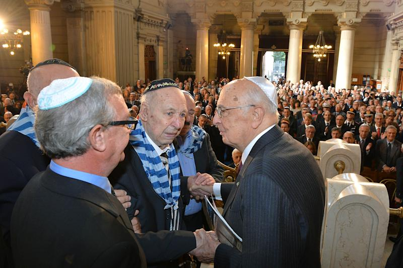 In this photo provided by the Presidential Press service, Italian President Giorgio Napolitano meets some survivors of the deportation of Jews from Rome's ghetto at the end of a ceremony to mark the 70th anniversary of the roundup, at the Rome Sinagogue Wednesday, Oct. 16, 2013. Italy marked the 70th anniversary of the roundup and deportation of Jews from Rome's ghetto amid turmoil over the late Nazi war criminal Erich Priebke and his Holocaust-denying final statement. (AP Photo/Antonio Di Gennaro, Italian Presidency press office) Antonio Di Gennaro