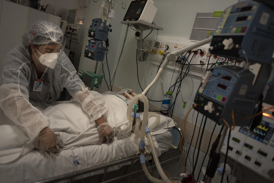 12.Mar.2021 - Intensive health professionals take care of patient in the covid-19 ICU of the Itapecerica da Serra General Hospital . Since the beggining of March, the hospital runs with 100% occupance during SP's (and Brazil's) worst phase of the pandemic. Everyday 3.300 people are admitted in SP state hospitals, that registers 29,962 inpatients this Easter Sunday (4) (Photo by Gustavo Basso/NurPhoto via Getty Images)