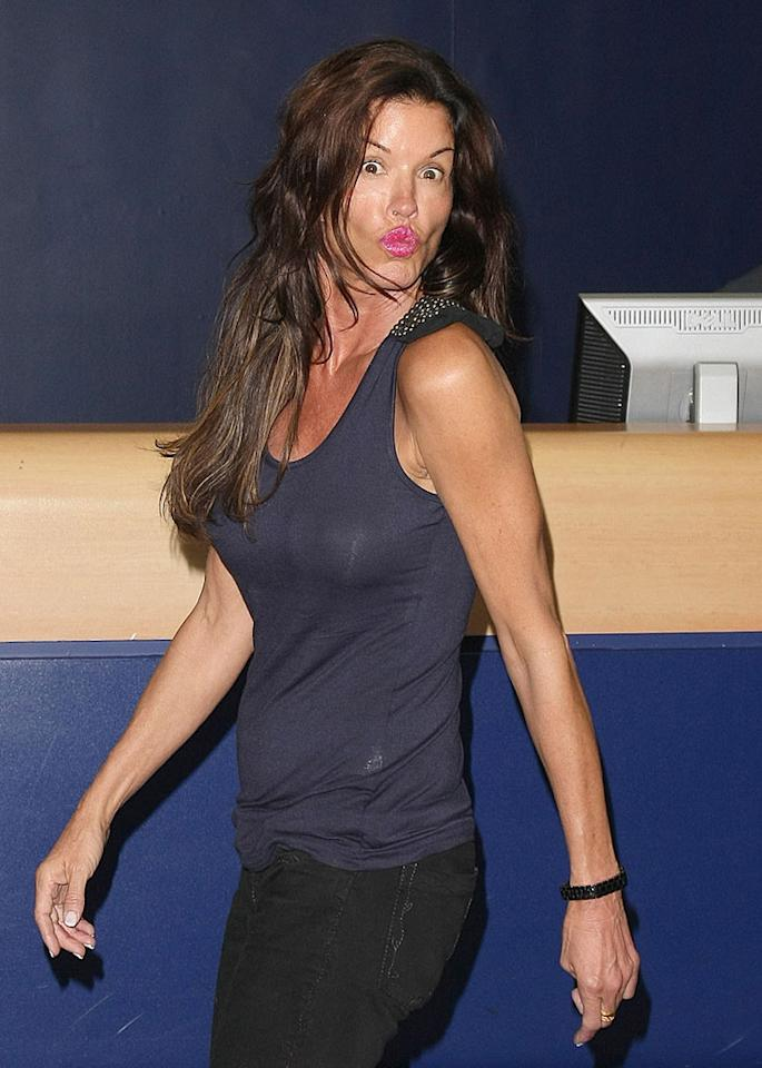 """Janice Dickinson, the world's self-proclaimed first supermodel, puckered up for the cameras while checking in for a flight at NYC's JFK International Airport. Daniel/Harding/<a href=""""http://www.infdaily.com"""" target=""""new"""">INFDaily.com</a> - June 27, 2010"""