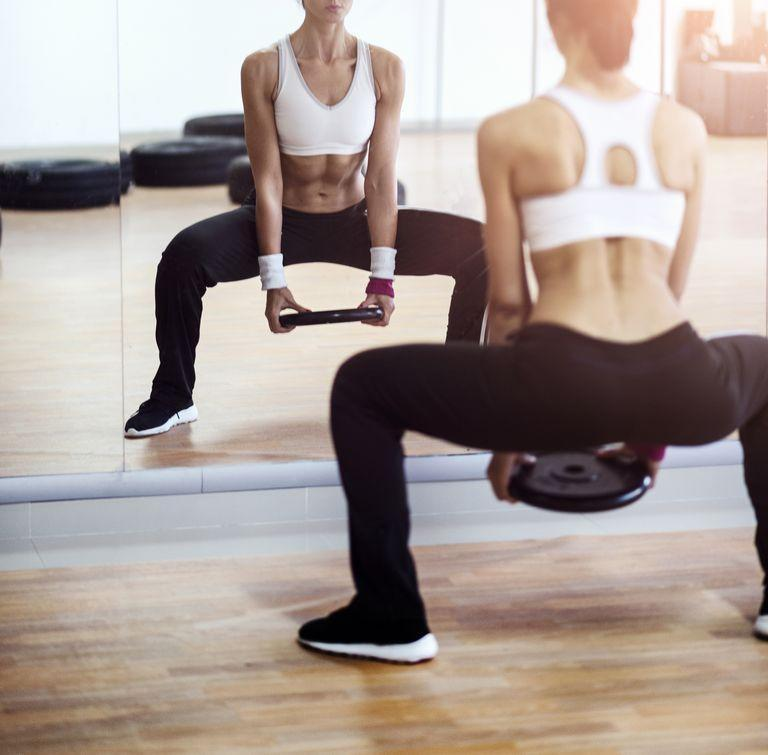"""<p class=""""body-text"""">Doing leg workouts at home is one of the best things you can do for your overall fitness. Not only do your legs contain some of your largest muscle groups (think: quads, hamstrings, glutes and calves) but they also help to build a strong foundation for other full and upper body workouts. </p><p class=""""body-text"""">And, no – you don't need access to a gym to work your muscles thoroughly. Building strength is all about time under tension, slow controlled movements and progressive overload. Meaning, to build lower body muscle (and see a visible change) you need to keep pushing your muscles to work harder than they did before. </p><p class=""""body-text"""">Fortunately, this can be done at home by changing tempos (slowing reps down), increasing the number of repetitions you perform and working with home gym equipment like dumbbells, kettlebells or resistance bands. <br></p><h2 class=""""body-h2"""">Can you build leg muscle without weights or machines?</h2><p>As we said before, machines are not necessary to help you build lower-body muscle. But, do you need weights? Annoying answer: it depends. Using weights during resistance training workouts will help to push your muscles to fatigue more quickly and this is what promotes muscle growth. However, if you're working with nothing but your <a href=""""https://www.harpersbazaar.com/uk/beauty/fitness-wellbeing/g32183508/best-yoga-mats/"""" rel=""""nofollow noopener"""" target=""""_blank"""" data-ylk=""""slk:yoga mat"""" class=""""link rapid-noclick-resp"""">yoga mat</a>, you can build leg muscle with bodyweight workouts, too. </p><h2 class=""""body-h2"""">The benefits of doing leg workouts at home </h2><p>The case for training your legs is plentiful – not least because of the benefits regular <a href=""""https://www.womenshealthmag.com/uk/fitness/strength-training/a706202/strength-training-for-beginners/"""" rel=""""nofollow noopener"""" target=""""_blank"""" data-ylk=""""slk:strength training"""" class=""""link rapid-noclick-resp"""">strength training</a> can have. If you're still on"""