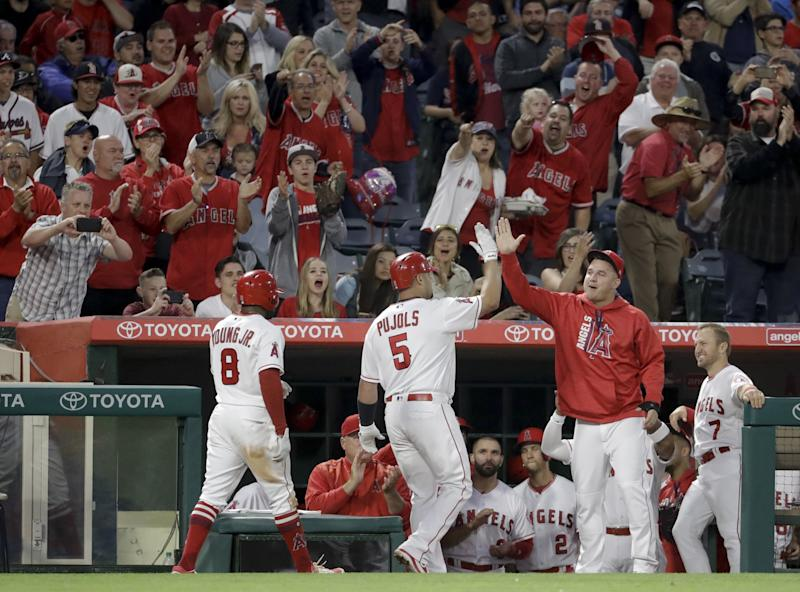 Albert Pujols celebrates homer No. 599. (AP)