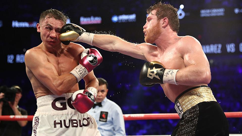 Pictured here, Gennady Golovkin cops a right to the face from Canelo Alvarez.