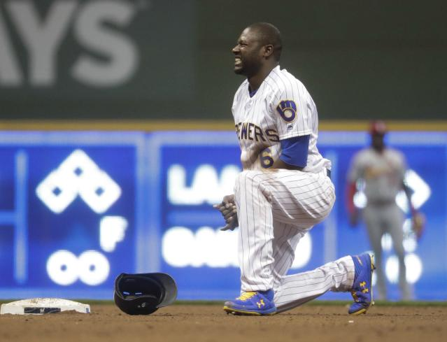 Milwaukee Brewers' Lorenzo Cain holds his hand after being caught stealing second during the fifth inning of a baseball game against the St. Louis Cardinals Friday, March 29, 2019, in Milwaukee. (AP Photo/Morry Gash)