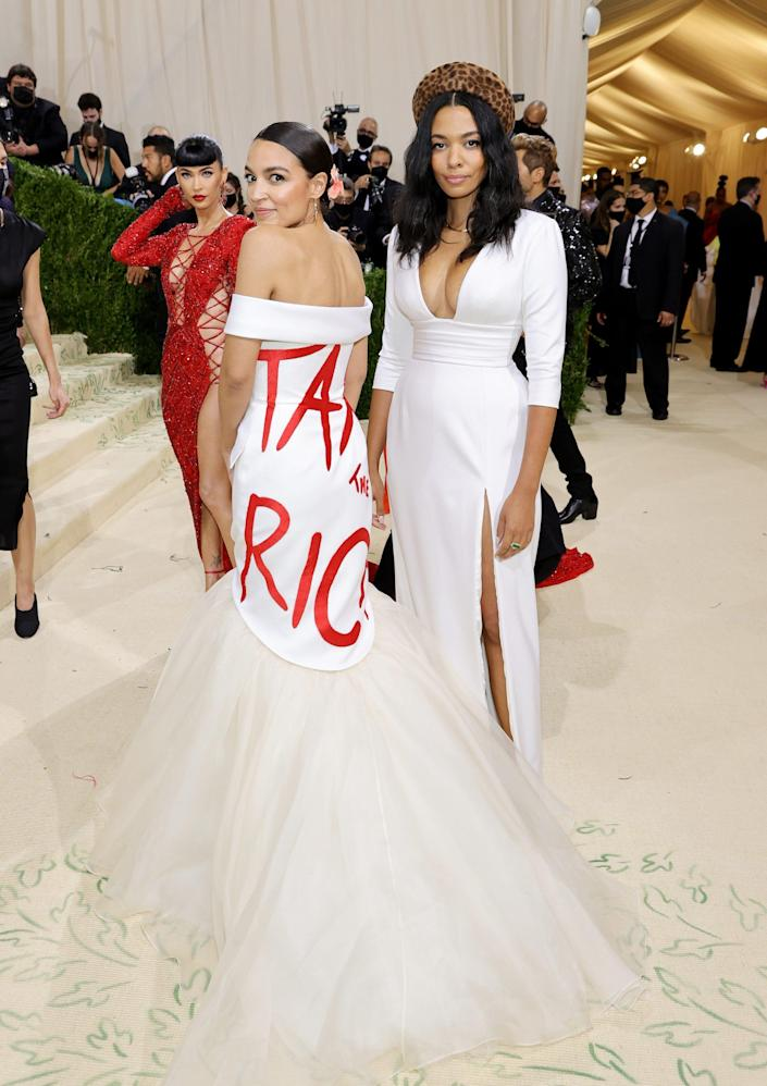"""A photo a Democratic Rep. Alexandria Ocasio-Cortez wearing a dress with the phrase, """"Tax the Rich"""" on it."""""""