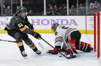 Chicago Blackhawks goaltender Corey Crawford (50) blocks a shot by Vegas Golden Knights right wing Mark Stone (61) during the second period of an NHL hockey game Wednesday, Nov. 13, 2019, in Las Vegas. (AP Photo/John Locher)