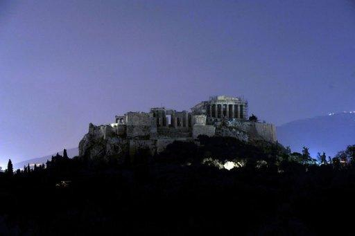 The Acropolis hill is pictured with its light switched off during the 'Earth Hour'