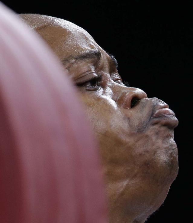 Nigeria's Felix Expo competes during the men's 77-kg, group B, weightlifting competition at the 2012 Summer Olympics, Wednesday, Aug. 1, 2012, in London. (AP Photo/Hassan Ammar)