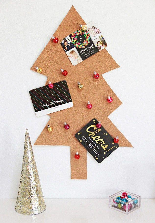 """<p>We're dying over the ornament push pins on this cork board tree.</p><p>Get the tutorial at <a href=""""http://abubblylife.com/2014/12/diy-christmas-tree-card-holder-ornamen.html/"""" rel=""""nofollow noopener"""" target=""""_blank"""" data-ylk=""""slk:A Bubbly Life"""" class=""""link rapid-noclick-resp"""">A Bubbly Life</a>.</p>"""