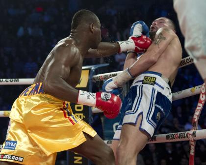 Adonis Stevenson, left, connects with a left in his win over Tony Bellew in November 2013. (AP)