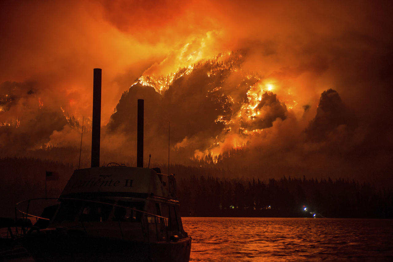 <p>Wildfire as seen from near Stevenson Wash., across the Columbia River, burning in the Columbia River Gorge above Cascade Locks, Ore., Sept. 4, 2017. (Tristan Fortsch/KATU-TV via AP) </p>