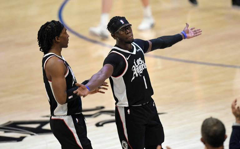Los Angeles Clippers Reggie Jackson, right, celebrates during a play stoppage with teammate Terance Mann during their 131-119 win over the Utah Jazz in game six of their second-round playoff series