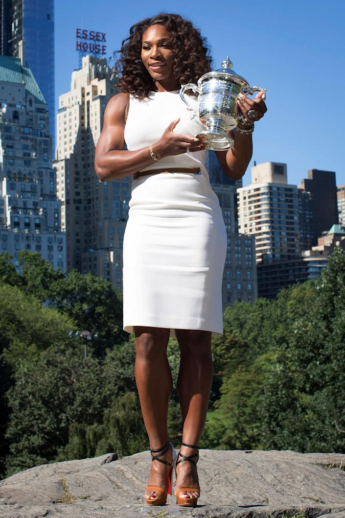 2012 U.S. Open Women's Singles champion Serena Williams poses for a photo with her trophy in Central Park, Monday, Sept. 10, 2012, in New York. This year alone, Williams claimed the U.S. Open trophy alongside the gold medals she won at the London Olympics and the silver plate she took home from Wimbledon. (AP Photo/John Minchillo)