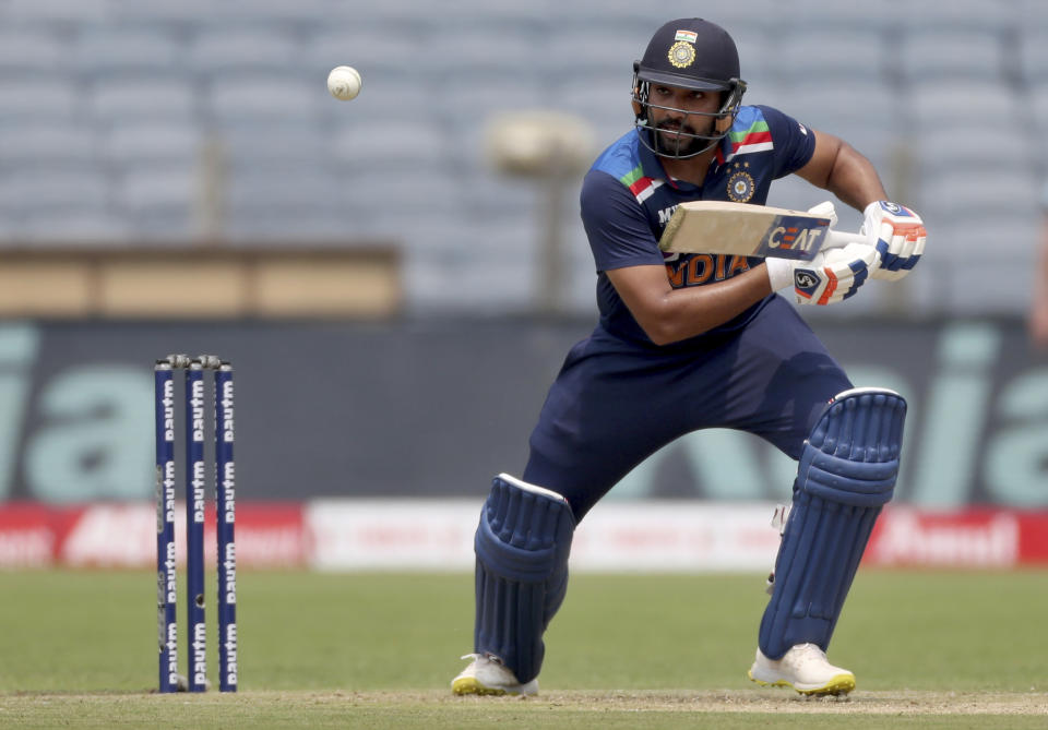 India's Rohit Sharma plays a shot during the first One Day International cricket match between India and England at Maharashtra Cricket Association Stadium in Pune, India, Tuesday, March 23, 2021. (AP Photo/Rafiq Maqbool)